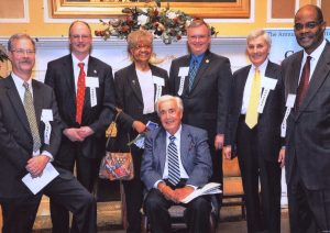 In 2011, Joe (back row, second from right) was among those honored with the Elder Law of Michigan Call to Justice award. Joe Cunningham being honored with Frank Kelley